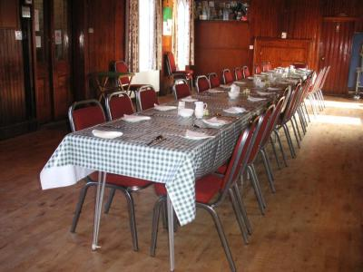 Hall set for lunch for 26